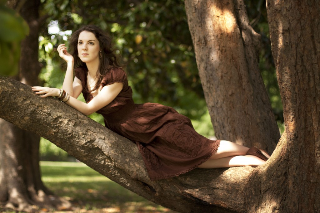 Brown peasant dress laying in a tree