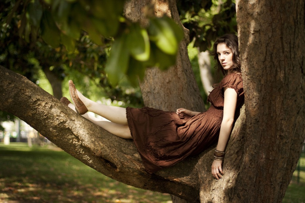Brown peasant dress sitting in a tree