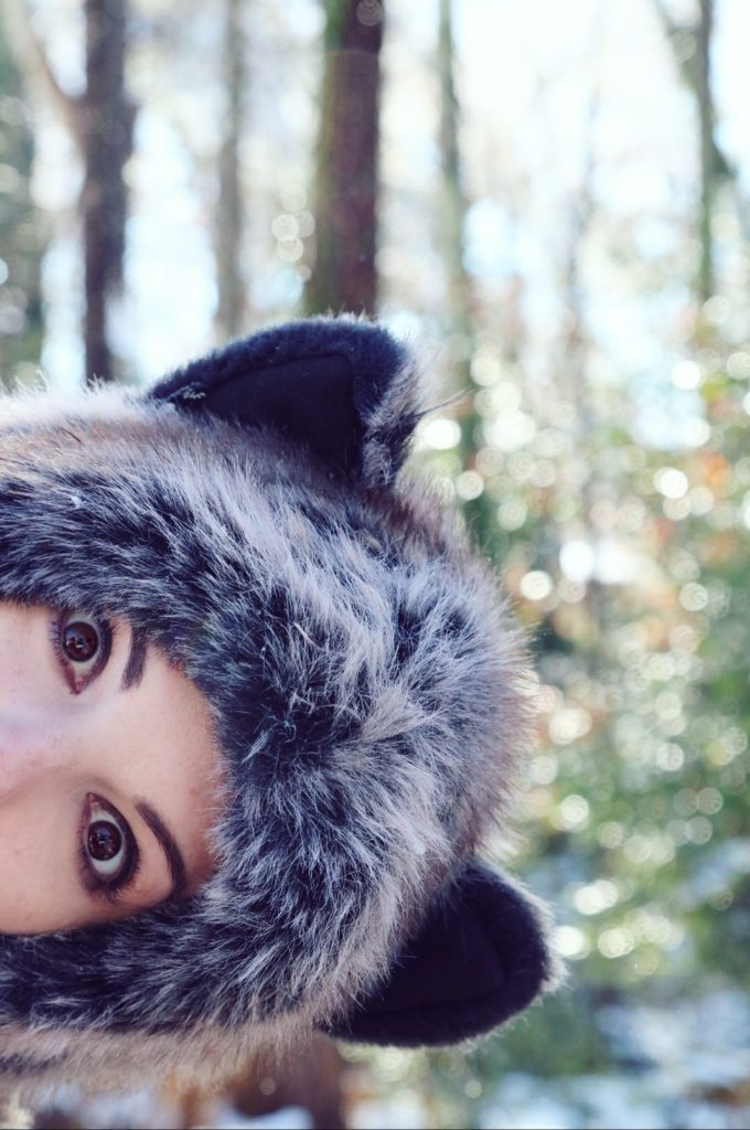 Peekaboo in a Grey Wolf Spirit Hood. Made in California. Worn by The Lady Nerd. Photographed by The Gluttonous Geek