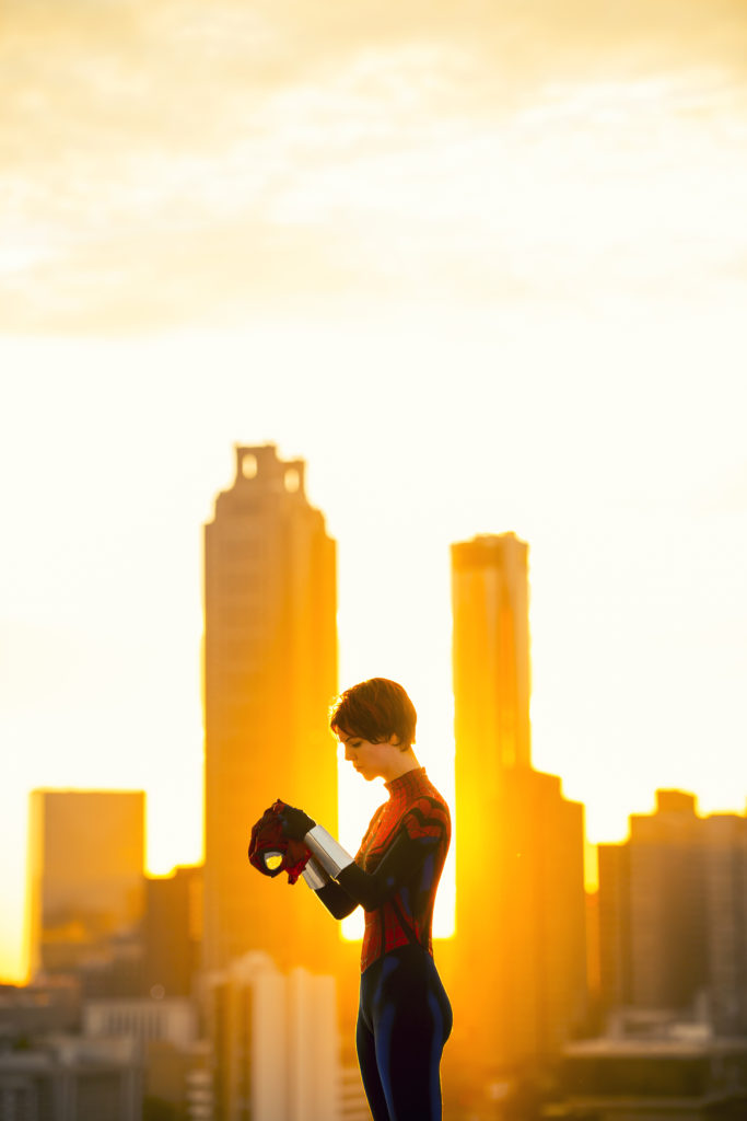 Spider-girl cosplay at sunset by The Lady Nerd. Photography by Hey It's Foto Mike. Suit by Kino Karou. Webshooters by Redhand Regalia.