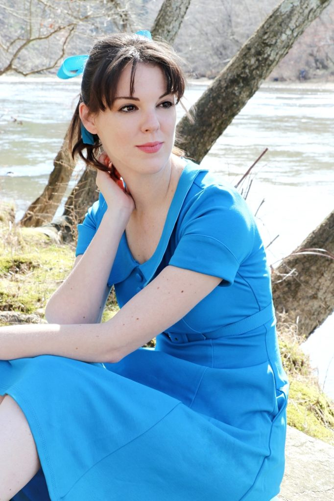 Sitting in a Pinup Girl Clothing Madison Dress worn by The Lady Nerd. Photographed by The Gluttonous Geek.